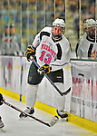 28 January 2012: University of Vermont Catamount forward Brett Bruneteau, a Graduate from Omaha, NB, sets up a play against the Northeastern University Huskies at Gutterson Fieldhouse in Burlington, Vermont. The Catamounts, dressed in their Breast Cancer Awareness jerseys, fell to the Huskies 4-2 in the second game of their 2-game Hockey East weekend series. Mandatory Credit: Ed Wolfstein Photo