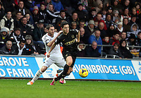 Wednesday, 01 January 2014<br /> Pictured L-R: Angel Rangel of Swansea against Samir Nasri of Manchester City. <br /> Re: Barclay's Premier League, Swansea City FC v Manchester City at the Liberty Stadium, south Wales.