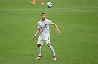 LOS ANGELES, CA - OCTOBER 25: Daniel Steres #5 of the Los Angeles Galaxy heads a ball during a game between Los Angeles Galaxy and Los Angeles FC at Banc of California Stadium on October 25, 2020 in Los Angeles, California.