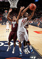 CHARLOTTESVILLE, VA- December 27: Mike Scott #23 of the Virginia Cavaliers grabs a rebound in front of /m532/ and Pina Guillaume #44 of the Maryland-Eastern Shore Hawks during the game on December 27, 2011 at the John Paul Jones Arena in Charlottesville, Va. Virginia defeated Maryland Eastern Shore 69-42.  (Photo by Andrew Shurtleff/Getty Images) *** Local Caption *** Pina Guillaume;Louis Bell;Mike Scott