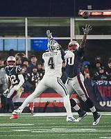 FOXBOROUGH, MA - NOVEMBER 24: New England Patriots Defensive lineman Adam Butler #70 tries to tip a pass from Dallas Cowboys Quarterback Dak Prescott #4 during a game between Dallas Cowboys and New England Patriots at Gillettes on November 24, 2019 in Foxborough, Massachusetts.
