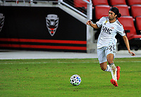 WASHINGTON, DC - SEPTEMBER 27: Lee Nguyen #42 of New England Revolution plays the ball during a game between New England Revolution and D.C. United at Audi Field on September 27, 2020 in Washington, DC.