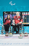 Ina Forrest and Jim Armstrong, Sochi 2014 - Wheelchair Curling // Curling en fauteuil roulant.<br /> Canada takes on Russia during round robin play // Le Canada affronte la Russie lors du tournoi à la ronde. 08/03/2014.