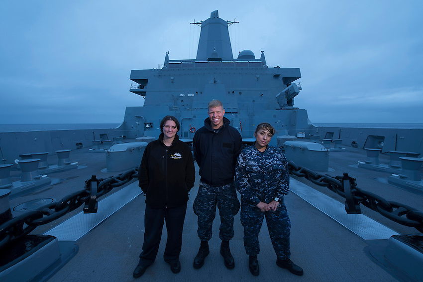 130427-N-DR144-088 Pacific Ocean (April 27, 2013)- Information Systems Technician 1st Class Ashley Faciane, left, assigned to the engineering department, Seaman Cruz Boseman, middle, assigned to the deck department, and Operations Specialist 2nd Class Gloria Hurtado, assigned to the operations department, pose for a photo on the foc'sle of San Antonio-class amphibious transport dock ship USS Anchorage (LPD 23). Faciane, Boseman, and Hurtado are all originally from Anchorage's namesake city of Anchorage, Alaska. Anchorage is currently en-route to Anchorage for its commissioning ceremony May 4. (U.S. Navy photo by Mass Communication Specialist 1st Class James R. Evans / RELEASED)