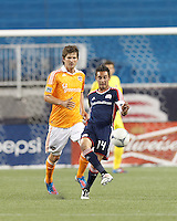 Second half substitute New England Revolution forward Diego Fagundez (14) attempts to control the ball as Houston Dynamo defender Bobby Boswell (32) closes. In a Major League Soccer (MLS) match, the New England Revolution tied Houston Dynamo, 2-2, at Gillette Stadium on May 19, 2012.
