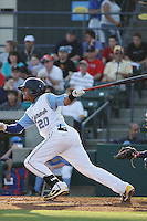 Myrtle Beach Pelicans outfielder Teodoro Martinez #20 at bat during a game against the Wilmington Blue Rocks at Tickerreturn.com Field at Pelicans Ballpark on April 8, 2012 in Myrtle Beach, South Carolina. Wilmington defeated Myrtle Beach by the score of 3-2. (Robert Gurganus/Four Seam Images)