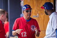 Buffalo Bisons manager Bobby Meacham (12) chats with hitting coach Devon White (right) prior to the game against the Durham Bulls at Durham Bulls Athletic Park on April 30, 2017 in Durham, North Carolina.  The Bisons defeated the Bulls 6-1.  (Brian Westerholt/Four Seam Images)