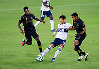 LOS ANGELES, CA - SEPTEMBER 23: Fredy Montero #12 of the Vancouver Whitecaps moves with the ball during a game between Vancouver Whitecaps and Los Angeles FC at Banc of California Stadium on September 23, 2020 in Los Angeles, California.