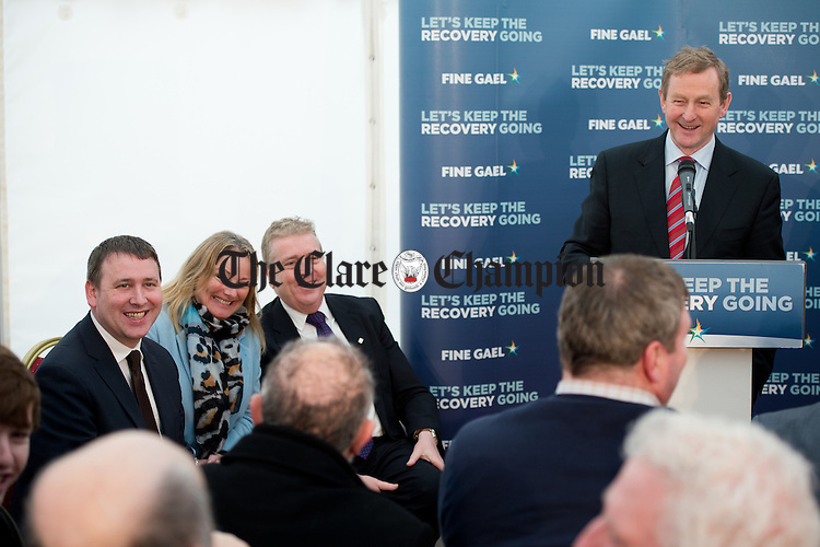 Enda Kenny, Taoiseach speaking watched by Joe Carey, TD, Councillor Mary Howard and Pat Breen, TD during his visit to Loop Head to launch the Fine Gael tourism initiative. Photograph by John Kelly.