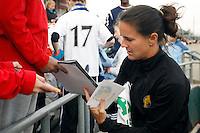 Brandi Chastain (6) of FC Gold Pride signs autographs before the game. Sky Blue FC and FC Gold Pride played to a 1-1 tie during a Women's Professional Soccer match at TD Bank Ballpark in Bridgewater, NJ, on April 11, 2009.