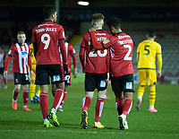 Lincoln City's Liam Bridcutt, right, celebrates scoring his side's equalising goal to make the score 1-1 with team-mates Tyreece John-Jules, left, and Jake Hesketh centre<br /> <br /> Photographer Andrew Vaughan/CameraSport<br /> <br /> The EFL Sky Bet League One - Lincoln City v Milton Keynes Dons - Tuesday 11th February 2020 - LNER Stadium - Lincoln<br /> <br /> World Copyright © 2020 CameraSport. All rights reserved. 43 Linden Ave. Countesthorpe. Leicester. England. LE8 5PG - Tel: +44 (0) 116 277 4147 - admin@camerasport.com - www.camerasport.com