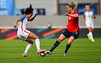 Sandefjord, Norway - June 11, 2017: Christen Press battles Ingrid Marie Spord      during their game vs Norway in an international friendly at Komplett Arena.