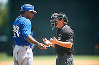 GCL Blue Jays manager Cesar Martin (29) argues a call with umpire Scott Molloy during a game against the GCL Braves on August 5, 2016 at ESPN Wide World of Sports in Orlando, Florida.  GCL Braves defeated the GCL Blue Jays 9-0.  (Mike Janes/Four Seam Images)