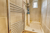 BNPS.co.uk (01202 558833)<br /> Pic: PropertyPublicity/BNPS<br /> <br /> Pictured: The shower<br /> <br /> Loco-cation, loco-cation, loco-cation..<br /> <br /> This quirky property that is up for sale is all about its loco-cation - as it sits on a railway crossing right next to the train tracks.<br /> <br /> The Grade II listed cottage was built in 1850 to house the gatekeeper whose job it was to close the gates at the road crossing whenever a train was due.<br /> <br /> The gates, in the village of Stone, Staffs, were automated many years ago.