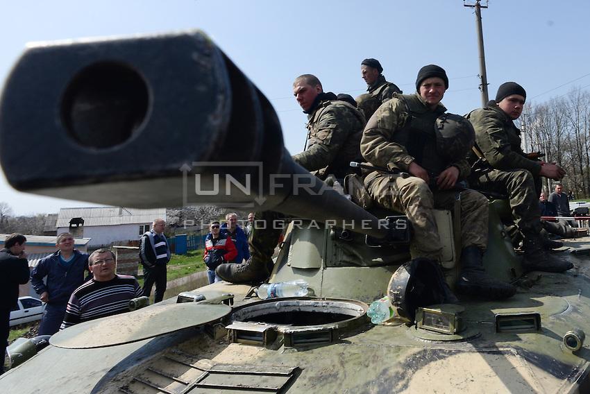 Ukrainian tank is being blocked by local citizens near Kramatorsk city during the anti-terrorist operation.