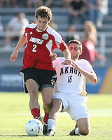 Chris Korb #16 of the University of Akron slides the ball away from Charlie Campbell #2 of the University of Louisville during the 2010 College Cup final at Harder Stadium, on December 12 2010, in Santa Barbara, California.Akron champions, 1-0.