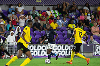 ORLANDO, FL - JULY 20: Joel Campbell #12 of Costa Rica dribbles the ball during a game between Costa Rica and Jamaica at Exploria Stadium on July 20, 2021 in Orlando, Florida.