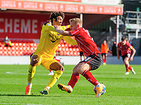 Lincoln City's Anthony Scully is fouled by Oxford United's Sean Clare<br /> <br /> Photographer Chris Vaughan/CameraSport<br /> <br /> The EFL Sky Bet League One - Saturday 12th September 2020 - Lincoln City v Oxford United - LNER Stadium - Lincoln<br /> <br /> World Copyright © 2020 CameraSport. All rights reserved. 43 Linden Ave. Countesthorpe. Leicester. England. LE8 5PG - Tel: +44 (0) 116 277 4147 - admin@camerasport.com - www.camerasport.com - Lincoln City v Oxford United