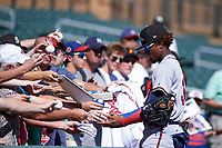 Peoria Javelinas outfielder Ronald Acuna (34), of the Atlanta Braves organization, signs autographs prior to an Arizona Fall League game against the Salt River Rafters on October 16, 2017 at Salt River Fields at Talking Stick in Scottsdale, Arizona.  Peoria defeated Salt River 6-2.  (Zachary Lucy/Four Seam Images)