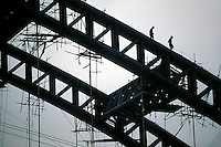 Labor on bridge construction in Guangdong, China. Construction spending in China will grow 9.7 percent annually through 2010, outperforming other major national construction markets..15 May 2007