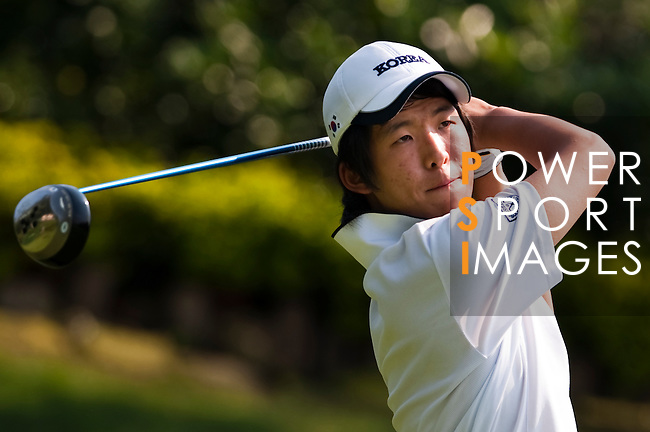 SHENZHEN, CHINA - OCTOBER 29: Chan-Won Han of South Korea watches his tee shot during the day one of Asian Amateur Championship at the Mission Hills Golf Club on October 29, 2009 in Shenzhen, Guangdong, China.  (Photo by Victor Fraile/The Power of Sport Images) *** Local Caption *** Chan-Won Han