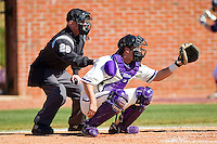 Catcher Josh Spano #21 of the High Point Panthers sets a target as home plate umpire Randy Collins looks on during the game against the Dayton Flyers at Willard Stadium on February 26, 2012 in High Point, North Carolina.    (Brian Westerholt / Four Seam Images)