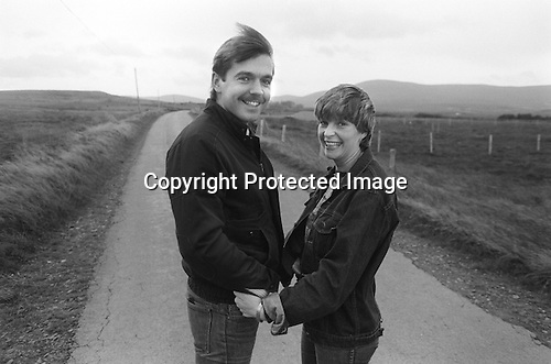 """John and Fiona Donnelly temporarily reunited across the border in Donegal, Ireland, where he is on the run. Accused by supergrass Raymond Gilmour of possessing a rifle, Donnelly jumped bail and fled. 1983.<br /> <br /> Fiona Donnelly writes,""""Well John and I celebrated our 40th wedding anniversary in June 2016. We have 4 beautiful children who are all professionals and are doing extremely well in their chosen field. We have 6 soon to be 7 grand children, all of whom bring much love and happiness to our lives.<br /> <br /> After the conflict we worked hard doing many different jobs and opened our own businesses which we ran until I took early retirement to help look after my grand children. After battling I'll health for along time, John now works in meditation trying to resolve conflict issues.<br /> <br /> Life has been good since Northern Ireland's troubles have settled and I'm happy that my grand children in particular will never know the conflict we and indeed our children knew."""""""