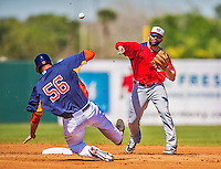 7 March 2013: Washington Nationals infielder Danny Espinosa turns a double play during a Spring Training game against the Houston Astros at Osceola County Stadium in Kissimmee, Florida. The Astros defeated the Nationals 4-2 in Grapefruit League play. Mandatory Credit: Ed Wolfstein Photo *** RAW (NEF) Image File Available ***