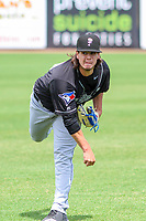 Lansing Lugnuts pitcher Maverik Buffo (44) warms up in the outfield prior to a Midwest League game against the Wisconsin Timber Rattlers on May 8, 2018 at Fox Cities Stadium in Appleton, Wisconsin. Lansing defeated Wisconsin 11-4. (Brad Krause/Four Seam Images)