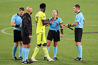 NASHVILLE, TN - SEPTEMBER 23: Referee Tori Penso exchanges a fist bump with Derrick Jones #21 of Nashville SC after a game between D.C. United and Nashville SC at Nissan Stadium on September 23, 2020 in Nashville, Tennessee.