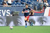 FOXBOROUGH, MA - MAY 22: Carles Gil #22 of New England Revolution during a game between New York Red Bulls and New England Revolution at Gillette Stadium on May 22, 2021 in Foxborough, Massachusetts.
