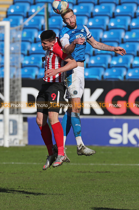 Peterborough United's Mark Beevers wis a header with Sunderland's Charlie Wyke during Peterborough United vs Sunderland AFC, Sky Bet EFL League 1 Football at London Road on 5th April 2021