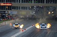 Jul, 20, 2012; Morrison, CO, USA: NHRA funny car driver Tim Wilkerson (right) races alongside Jeff Arend during qualifying for the Mile High Nationals at Bandimere Speedway. Mandatory Credit: Mark J. Rebilas-US PRESSWIRE