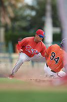 Philadelphia Phillies Nicolas Torres (18) puts a tag on Nick Horvath (94) as he slides into second base during a Florida Instructional League game against the Baltimore Orioles on October 4, 2018 at Ed Smith Stadium in Sarasota, Florida.  (Mike Janes/Four Seam Images)