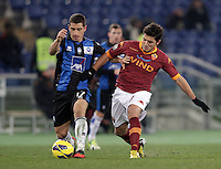 Calcio, ottavi di finale di Coppa Italia: Roma vs Atalanta. Roma, stadio Olimpico, 11 dicembre 2012..Atalanta midfielder Carlos Carmona, of Chile, and AS Roma midfielder Marquinho, of Brazil, right, fight for the ball during their Italy Cup last-16 tie football match between AS Roma and Atalanta at Rome's Olympic stadium, 11 december 2012. .UPDATE IMAGES PRESS/Riccardo De Luca