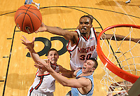 Virginia's Adrian Joseph (30) reaches for the rebound over teamate Laurynus Mikalauskas and North Carolina's Tyler Hansbrough during a college basketball game Thursday, Jan. 19, 2006, at University Hall in Charlottesville, Va. Virginia won 72-68.