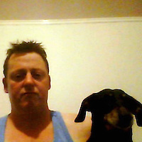 Pictured: A picture taken from Robert Riley's twitter page showing him with a pet dog.<br />