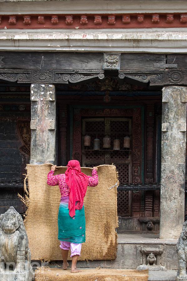 Woman Carrying Threshing Mat in Bungamati, Nepal