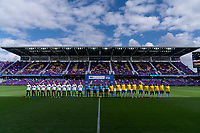 ORLANDO, FL - FEBRUARY 21: The USWNT and Brazil stand during the national anthems before a game between Brazil and USWNT at Exploria Stadium on February 21, 2021 in Orlando, Florida.