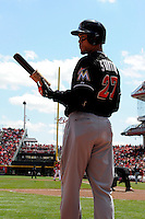 Miami Marlins outfielder Giancarlo Stanton #27 on deck during a game against the Cincinnati Reds at Great American Ball Park on April 20, 2013 in Cincinnati, Ohio.  Cincinnati defeated Miami 3-2 in 13 innings.  (Mike Janes/Four Seam Images)