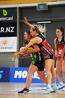 Pulse's Te Amo Amaru-Tibble is pressured by Jane Watson during the ANZ Premiership netball match between Central Pulse and Mainland Tactix at Te Rauparaha Arena in Wellington, New Zealand on Friday, 9 July 2021. Photo: Dave Lintott / lintottphoto.co.nz
