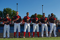 Batavia Muckdogs Harrison White (40), Micah Brown (55), J.C. Millan (4), Terry Bennett (33), Rony Cabrera (26), and Lazaro Alonso (19) during the national anthem before a game against the Auburn Doubledays on July 4, 2017 at Dwyer Stadium in Batavia, New York.  Batavia defeated Auburn 3-2.  (Mike Janes/Four Seam Images)