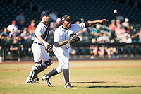 Mesa Solar Sox starting pitcher Gregory Soto (65) throws to first base in front of catcher Jake Rogers (8), both of the Detroit Tigers organization, during an Arizona Fall League game against the Salt River Rafters at Sloan Park on November 9, 2018 in Mesa, Arizona. Mesa defeated Salt River 5-4. (Zachary Lucy/Four Seam Images)