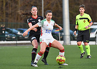 Luna Vanzeir (10) of OHL pictured defending the ball for Romy Camps (3) of Zulte-Waregem during a female soccer game between Oud Heverlee Leuven and SV Zulte-Waregem on the 16 th matchday of the 2020 - 2021 season of Belgian Womens Super League , sunday 14 th of March 2021  in Heverlee , Belgium . PHOTO SPORTPIX.BE | SPP | DAVID CATRY
