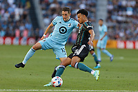 ST PAUL, MN - AUGUST 14: Ethan Finlay #13 of Minnesota United FC and Niko Hamalainen #15 of the Los Angeles Galaxy battle for the ball during a game between Los Angeles Galaxy and Minnesota United FC at Allianz Field on August 14, 2021 in St Paul, Minnesota.