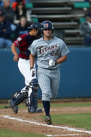 Shawn Scobee of the Cal State Fullerton Titans runs to first base during a 2004 season game against the Loyola Marymount Lions at Loyola Marymount in Los Angeles, California. (Larry Goren/Four Seam Images)