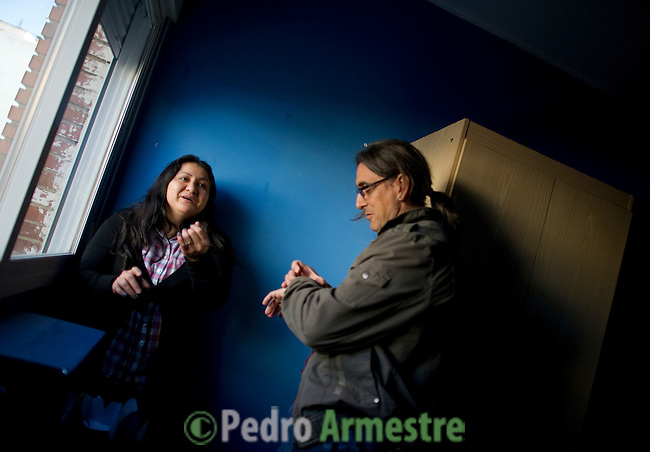 Ecuadorian homeowner Kelly Herrera (L) speaks on March 13, 2012 with a psychologist in her house in Madrid before being evicted. Spain on March 9 approved a new voluntary 'code of conduct' for banks which aims to help poor homeowners settle their debts and reduce a wave of evictions brought on by the economic crisis. Spanish banks currently seize the homes of those who default on their mortgages and often demand further payment from those evicted if the value of the house has fallen below that of the loan. The new rules will apply in cases where every member of a household is unemployed and mortgage payments are equal to more than 60 percent of their income. (c) Pedro ARMESTRE