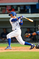 Mauricio Ramos (3) of the Burlington Royals follows through on his swing against the Princeton Rays at Burlington Athletic Park on July 5, 2013 in Burlington, North Carolina.  The Royals defeated the Rays 5-1 in game one of a doubleheader.  (Brian Westerholt/Four Seam Images)