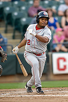 Secondbaseman Anderson Hernandez #12 of the Oklahoma City RedHawks swings against the Round Rock Express on April 26, 2011 at the Dell Diamond in Round Rock, Texas. (Photo by Andrew Woolley / Four Seam Images)
