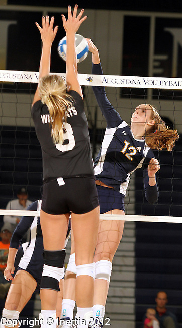 SIOUX FALLS, SD - SEPTEMBER 18:  Holly Hafemeyer #12 from Augustana tries to get a kill past Lexi Malm #3 from Wayne State in the first match of their game Tuesday night at Augustana. (Photo by Dave Eggen/Inertia)